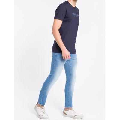 Calça Jeans Masculina Five Pockets Super Skinny com Puídos Cintura Baixa Azul Claro Calvin Klein